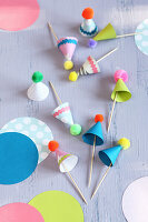 Toothpicks decorated with colourful, handmade party hats