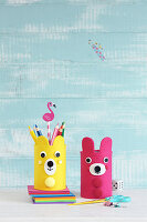 Bear-shaped pen holders made from tin cans and foam rubber