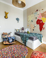 Map of world decorating wall above bed in child's bedroom