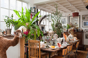 Set table decorated with bizarre curiosities in former factory sales area