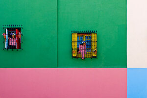 Windows in colourful external wall building
