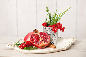 Still life with pomegranate and red currants