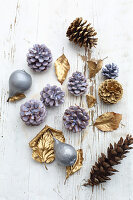 Fruits, pine cones and leaves dipped in coloured wax or sprayed gold