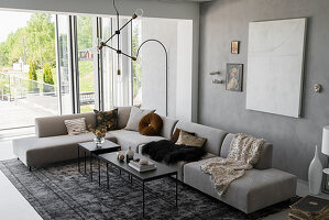 Corner sofa and floor-to-ceiling terrace doors in grey living room