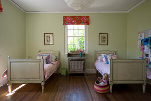 Old twin beds in simple children's bedroom