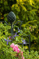 Trellis with a rose stick and climbing roses in the garden