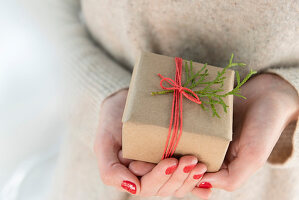 Woman holding small Christmas present