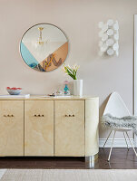 20s Style credenza in home office with circle three tone tinted mirror