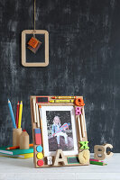 Photo of child on first day of school in hand-crafted picture frame