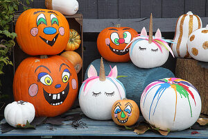 Handcrafted Halloween decorations: pumpkins with various faces