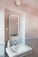 Mirror in niche above sink in classic bathroom