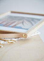 Picture frame with handmade leather loop