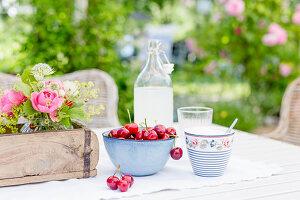 Cherries and lemonade on garden table