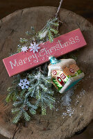 Christmas-tree decorations, fir branch and festive greeting