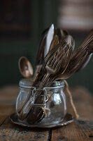 Vintage cutlery in jar