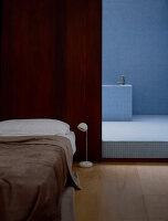 Mosaic tiles in ensuite bathroom of minimalist bedroom