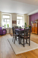 Dark dining set in interior with purple accents