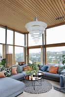 Grey sofa set in living room with glass walls