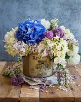 Spring bouquet with hydrangea flowers and lilacs