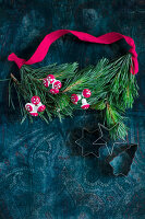 Garland of pine twigs with toadstool decorations