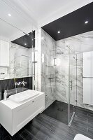 Classic bathroom in black, grey and white with marble tiles