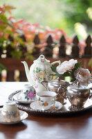 China tea set, silver milk jug and sugar bowl on silver tray