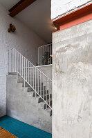Concrete staircase in open-plan interior
