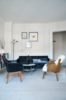 Living room in Scandinavian mid-century style with leather sofa