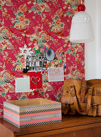 Box covered with washi tape in front of red Asian wallpaper
