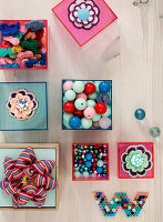 Transparent boxes with craft materials