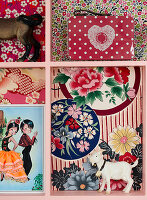 Typecase lined with patterned paper and kitschy decoration