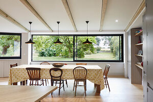 Open plan dining room with large windows looking out onto the garden