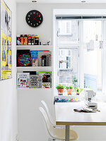 Open shelving next to the kitchen table