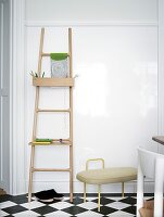 Ladder with shelf on the wall on checkered floor