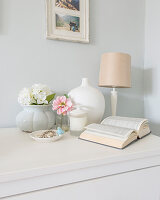 Charming arrangement of open book and vases
