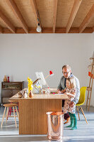 Father and daughter at desk with various stools