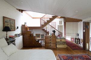 Rustic eclectic bedroom on intermediate level