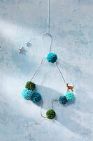 Christmas tree handmade from wire coat hanger and pompoms