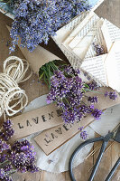 Bunch of lavender in paper cone, folded envelopes and stamped paper signs