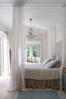 Romantic bedroom in Scandinavian style with canopy