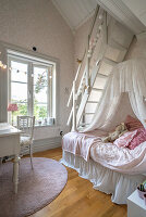 Bed below ladder leading to gallery in charming girl's bedroom