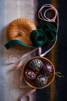Four Christmas baubles in jewellery box and ribbons