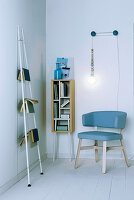 Books on shelves and ladder and DIY reading lamp in reading corner