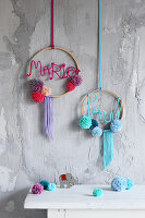 Handmade wreaths with names and pompoms