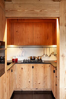 U-shaped fitted kitchen with wooden cupboards