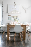 Shell chair at set wooden table in white dining room