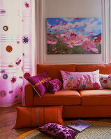 Orange sofa with pink scatter cushions