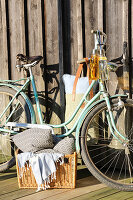 Bicycle with cushions and blankets for picnic on lake