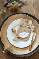 Place setting decorated with handmade name card and gift bag
