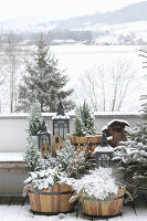 Planted half-barrels on balcony with view of snowy landscape